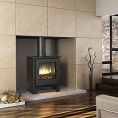 The Broseley Evolution Desire 6 Electric Stove provides the shimmer and smoulder of a woodburning stove but in the most convenient form. It is part of the Evolution range of stoves and features a modern contemporary steel design in a matt black finish. Contemporary Wood Burning Stoves, Log Burning Stoves, Multi Fuel Stove, Electric Stove, Log Burner, Logs, Sheffield, Living Spaces
