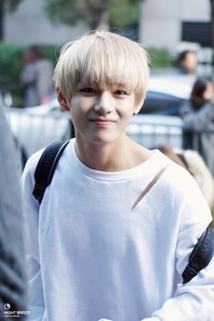 V/Taehyung - still so young here.. I can't believe how much he suits that blond hair.. it looks amazing...