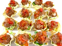 Delight your guests with these itty, bitty meatballs atop a mini tostada. This is such a yummy and simple appetizer to make that it might just become your go-to recipe!  The skinny for each appetizer, 31 calories 1 gram fat and 1 Weight Watchers POINTS PLUS.  So cute and so fun to eat!