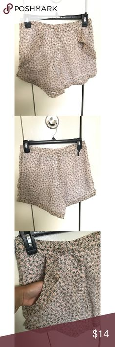 "TopShop High-Waisted shorts TopShop pink with white butterflies pattern high waisted shorts. Front pockets and loose leg fit. Used once, in great condition. Approximately 12"" front rise and 3.5"" inseam. Topshop Shorts"