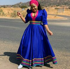 Winnie Mashaba In Blue Patterned Sepedi Flared Dress With Pink Headwrap and White Sneakers - Clipkulture Shweshwe Dresses, African Maxi Dresses, Latest African Fashion Dresses, African Dresses For Women, African Attire, African Outfits, African Clothes, Ankara Fashion, Tribal Fashion
