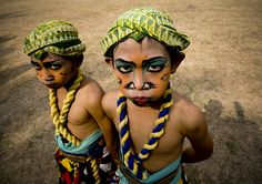 """Kids dressed for Kuda Lemping dance, Java, Indonesia    Seni Kuda Lemping ,a traditional dance of Java is one of these trance dances, in which masks for spirit characters and flat woven bamboo horses are the main props. The dance is about the battle of good and evil, with the horse riding characters going into a trance where they behave like horses. Kuda Lemping literally means """"flat horses.""""  Borobudur Java Indonesia    © Eric Lafforgue  www.ericlafforgue.com"""