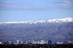 Downtown San Jose, with snow in the mountains. This was taken from the Novitate Winery (now Testarossa Winery) in Los Gatos, California   http://www.plumbingtechsj.com/