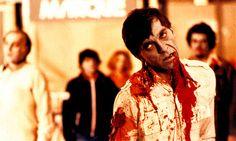 """Dawn of the Dead (1978) was the brilliant follow-up to George Romero's """"Night of the Living Dead"""" in 1968. It combined black comedy with absolute terror and gore to create a zombie movie that hasn't been surpassed. In this scene, Steve the helicopter pilot-now zombie is coming for his still alive friends. This movie was able to show society crumbling and ineffectual attempts to come to grips with the nightmare in a real and terrifying way while the stars scramble to survive in a dying world."""