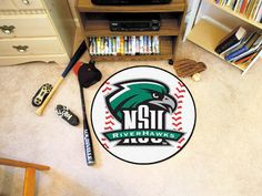 """The Northeastern State RiverHawks Baseball Mat is a fantastic small area rug for any NSU RiverHawks Man Cave, game room or fans Bedroom or office. The 26"""" diameter baseball-shaped floor mat is proudly"""