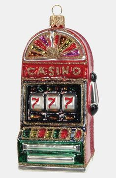 If you're looking to celebrate a fun trip to Las Vegas or other casinos, this slot machine ornament makes a great addition to your Christmas tree. Hot Wheels, Minis, Las Vegas, Vegas Casino, Casino Night, Party Friends, Slot Machine Cake, Blown Glass Christmas Ornaments, Cars 1