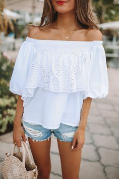 This eyelet off-the-shoulder top is the makes for the perfect summer look.