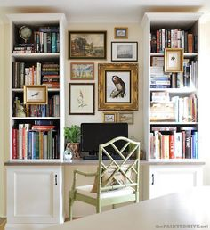 desk space between two bookshelves (love the nature prints)