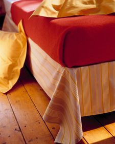 Use a sheet or other fabric as a simple bed skirt/dust ruffle that's not frou-frou