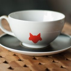 There are plenty of ways to use Martha Stewart's Glass Paints to enliven your dishes, such as the case of these teacups.