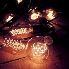 Vintage filament festoon lighting sitting on exposed floorboards
