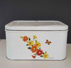 vintage white enamel farmhouse bread box with orange and yellow floral decoration