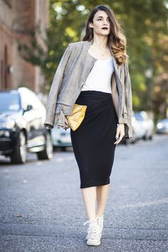 Anisa Sojka wearing dove grey Samsoe capucine jacket, white Gina Tricot t-shirt, black H&M pencil skirt, yellow Arthur Szenfeld clutch with silver studs and white hi-top Converse sneakers. Street style shot in London by Cristiana Malcica.