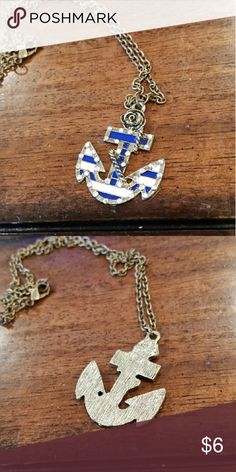 Vintage Anchor Necklace Stylish bronzed, white and blue anchor necklace topped with a cute, small rose!  Chain: 9 inches Pendant: 1 1/2 inches Accessories