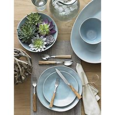 Marin Blue 16-Piece Dinnerware Set in Dinnerware Sets | Crate and Barrel  I LOVE the combination of pale pastels with the natural table AND succulents!