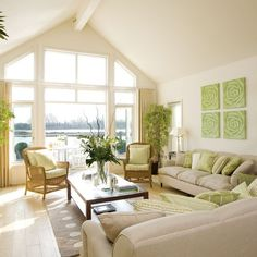Waterfront living room    Keep architectural windows like these free of elaborate treatments, to maximise light and space. This waterfront living room brings the outside in with a far-reaching view, plus plenty of greens and creams to keep the look bright and fresh.