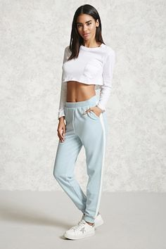 Style Deals - A pair of French terry knit sweatpants featuring colorblocked stripes at each side, an elasticized waist, and ribbed knit trim.