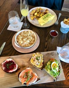 """Brunch: mimosas, French omelette, mac + cheese, and 4 toast assortment (avocado, crab """"waldorf"""", fresh strawberry compote, salmon) Restaurant History, French Omelette, Butter Poached Lobster, Brick Oven Pizza, Strawberry Compote, Great Recipes, Favorite Recipes, Chicken And Waffles, New Menu"""