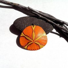 Painted sand dollar pendant bright orange yellow copper
