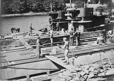 U-boat crews unload ammunition and supplies from their craft. GERMAN U-BOATS SURRENDER AT LISAHALLY, NEAR LONDONDERRY, NORTHERN IRELAND, 24 - 25 MAY 1945.
