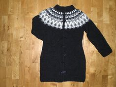 Womens long wool sweater with buttons. Made of wool from Iceland called Lopi, very nice and warm.