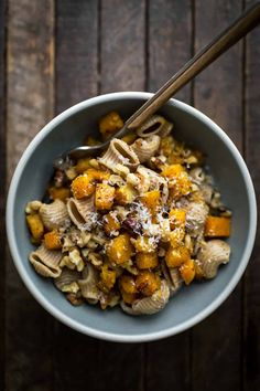 An flavorful vegetarian butternut squash pasta dish featuring roasted rosemary squash tossed with hearty wheat pasta, walnuts, butter, and parmesan.