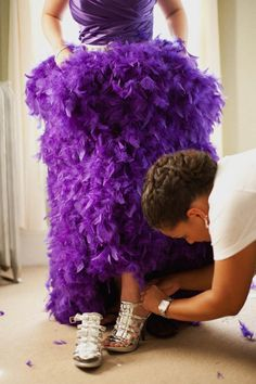 Purple wedding dress with feathers ! Love it!   3 Ways to Use Feathers on your Wedding Day!