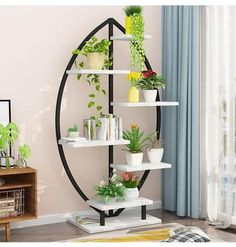 Finally, an amazing art deco planter display stand to fit with your decor perfectly.Includes 6 shelves to display your favorite indoor plants, photo frames, or books.Made from wood & metal. House Plants Decor, Plant Decor, Decorating Your Home, Diy Home Decor, Room Decor, Plant Shelves, Display Shelves, Arte Art Deco, Regal Display