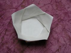 This is a ceramic bowl, though would love to try and do this with paper! Anyone know where I can find the instructions?