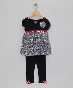 Designed for total convenience and maximum charm, this simple-to-sport set takes the guesswork out of dressing little ones for the day. Cleverly coordinated both top and bottom, it boasts easy-on leggings and a sparkle-sprinkled tunic with fluttering ruffle tiers.