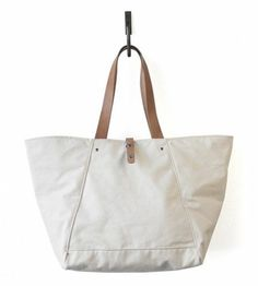 d7b0c99f4f6 A heavy duty canvas tote bag from Makr Carry Goods. With natural leather  straps that