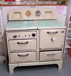 I found one just like this at the antiques place downtown!! 1930's Wedgwood stove!