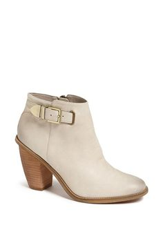 love absolutely everything about these ivory chunky heel booties with gold ankle buckle