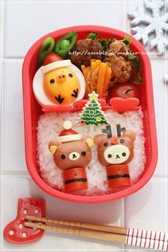 Rilakkuma Christmas bento ~ mini hot dog figures on rice bed plus Kiiroitori egg   by mahiro-mama