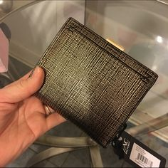 Zac Posen Wallet Super sleek and functional wallet. Slot for bills, ID Window, plenty of space for Credit card and receipts. Double coin pouch. Would match either Zac Posen purse I have listed very well! Zac Posen Bags Wallets