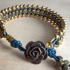 Pacific blue leather bracelet woven with bronze and gold beads