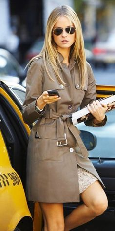 Career woman Light brown trench and aviators