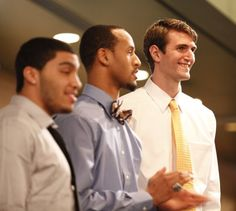 Releford with a bow-tie~ Kansas center Jeff Withey smiles as he is recognized before those gathered during the Men's Basketball Banquet on Monday, April 9, 2012 at the Holidome. Also pictured are Niko Roberts, left, and Travis Releford.