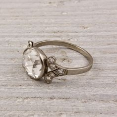 Vintage / Estate Rose cut diamond ring.  This is a very sweet Art DECO engagement ring made in PLATINUM and set with an approximately 1 CARAT rose-cut diamond. The diamond is beautifully accented with ten rose cut diamonds (five on each side). Circa 1925