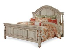 The Belmar II queen panel bed conjures an atmosphere reminiscent of generations of summer afternoons spent at a family coastal cottage. A distinctively casual environment is created through heirloom-like pieces. Flowing movement is conveyed through the serpentine shapes, fluted posts and three-quarter turnings. Thick stepped crown molding, waist molding and carved dentil molding give an unexpected classic feel to the casual coastal style.