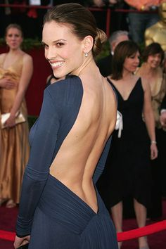 Hilary Swank in Laroche, 2005:  The actress, famous for masculine roles in films like Boys Don't Cry and Million Dollar Baby (which she Best Actress for in this dress), showed off her feminine side.  Apparently, her feminine side is her back:  and amazing back muscles! This dangerously low back worked because of the conservatively high front, making this gown the Holy Grail of backless dresses.