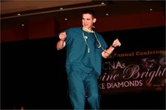 Dane Henning, National Association of Health Care Assistants Marketing Director, dancing on the runway in the new AVE Scrubs.