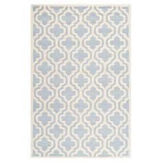Anchor your living room seating group or define space in the den with this artfully hand-tufted wool rug, showcasing a quatrefoil ogee motif for eye-catching...