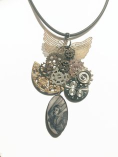 Steampunk style necklace | Steampunk fashion | Necklace of recycled parts and flying man  This one is a doozie - the flying glider man is a handmade