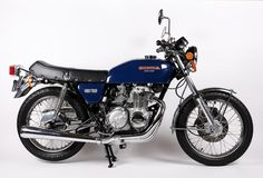 "The most distinctive feature of the Honda CB400F was the exhaust – some people referred to the headers as ""waterfall pipes."" It wasn't as fast as its competition, this little four cylinder was smoother, quieter, and gave better gas mileage."
