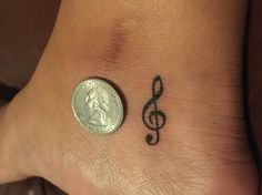 Treble clef ankle tattoo almost the size of a quarter!