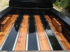 alternating wood stain colors on wood bed floor panels with wooden wheel tubs.