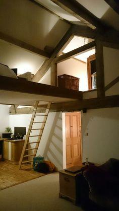 Mezzanine sleeping platform with Queen post truss dressing room