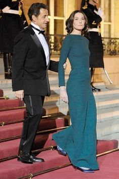 Carla Bruni-Sarkozy at an Elysee Palace dinner to honor Russian President Dmitry Medvedev in March 2010, in RM by Roland Mouret 2009 gown and Christian Louboutin kitten heels