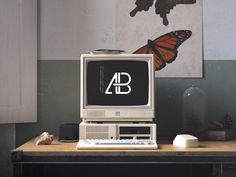 Today's freebie is a Retro IBM Desktop Mockup by Anthony Boyd Graphics. Use this vintage desktop scene to showcase your website designs or any branding work you might have. This scene was created in Cinema and rendered using Redshift Render. Computer Mockup, Web Design Projects, Free Photoshop, Grafik Design, Ibm, Logo Nasa, Retro, Branding Design, Logo Design